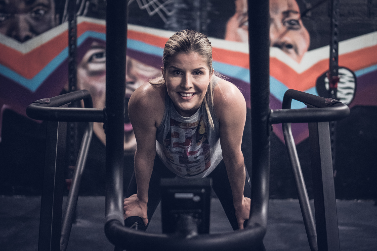 Happy woman training in a urban gym