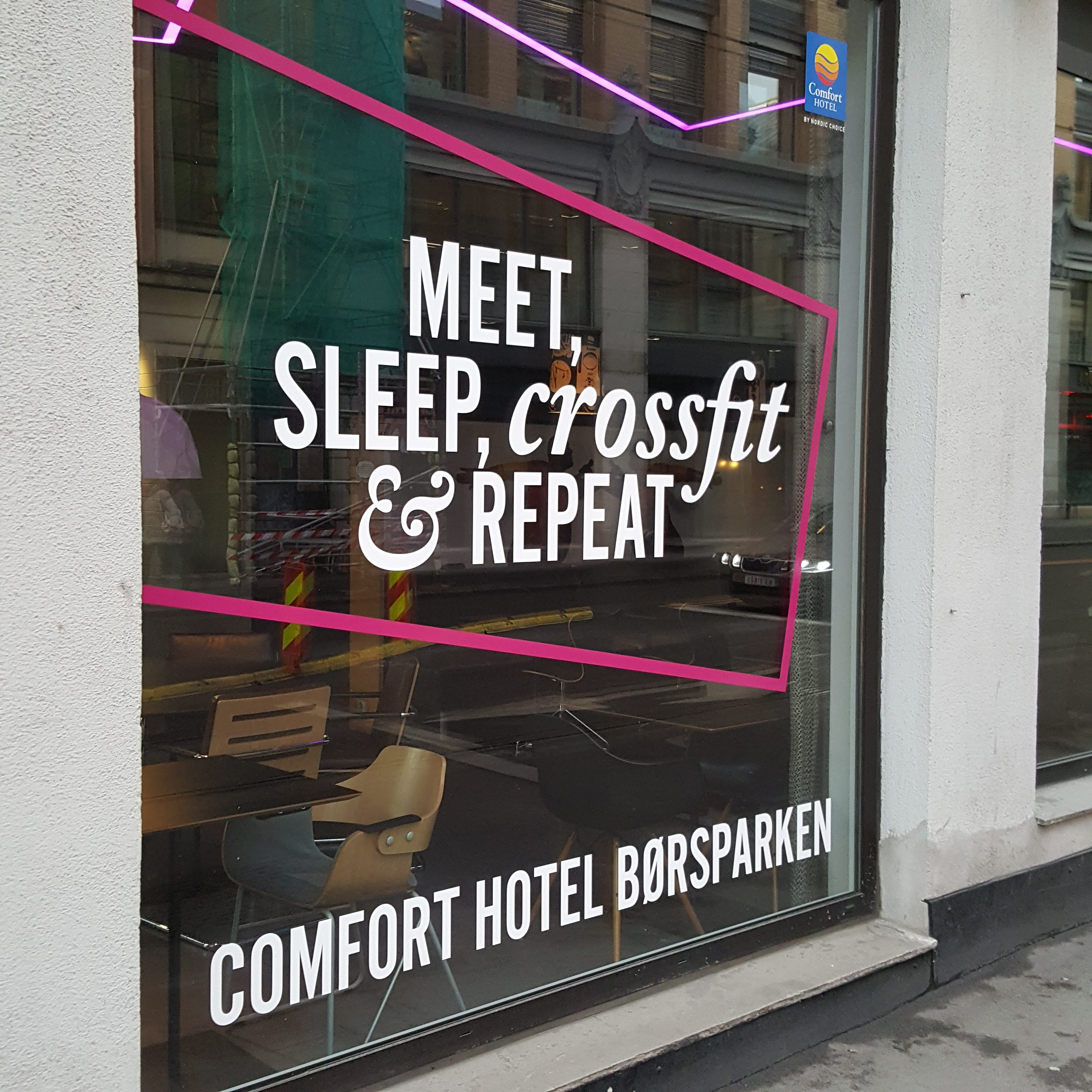 Picture of a slogan at Comfort Hotel, reading Meet, sleep, crossfit and repeat